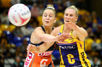 Jamie-Lee Price and Laura Langman compete for the ball.