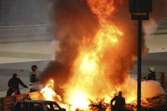 Marshals extinguish flames after Romain Grosjean's horror crash in Bahrain.