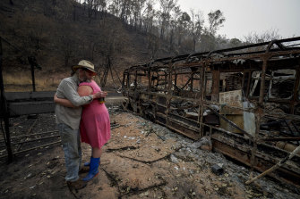 Mark Brooks hugs his daughter Kylee after losing his home in the fires.