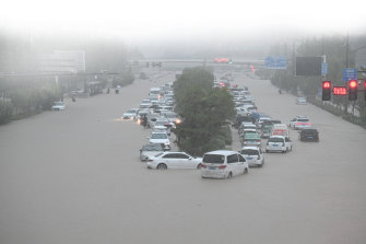Vehicles are stranded in floodwater near Zhengzhou Railway Station on July 20.