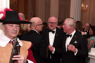 Prince Charles and George Brandis speak with another guests at the exclusive event.