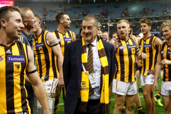 Jeff Kennett with Hawthorn players after their one point win over Essendon on Saturday.