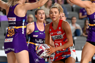 Swamped: Swifts attack Helen Housby surrounded by the Firebirds defence.
