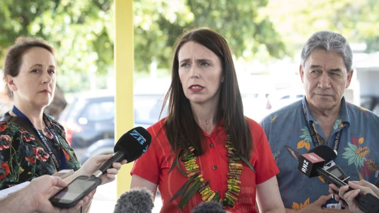 New Zealand Prime Minister Jacinda Ardern, centre, and Foreign Affairs Minister Winston Peters, right, speak to the media during the Pacific Islands Forum in Nauru.