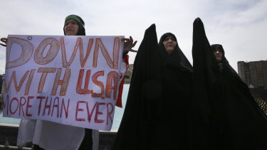 Iranian women attend an anti-US gathering after the Friday prayer in Tehran.