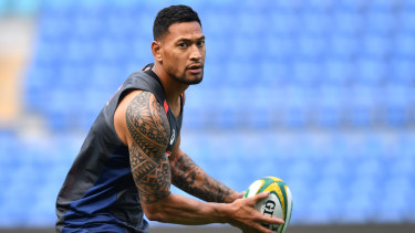 Cover up: Players like Israel Folau will be required to hide their tattoos at next year's World Cup.