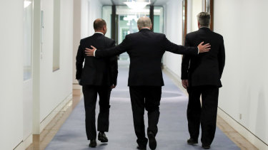 Treasurer Josh Frydenberg, Prime Minister Scott Morrison and Minister for Finance Mathias Cormann leave the press conference held after passing the government's tax cuts.