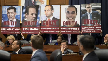 Posters of people who have pleaded guilty in Robert Mueller's probe are shown during a joint House committee hearing in Washington.