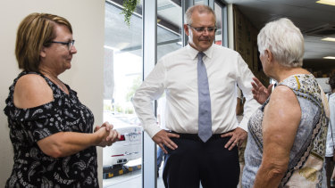 Prime Minister Scott Morrison meets voters Gayle Price-Davies and Gwyneth Hockey in Brisbane.