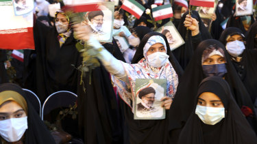 Supporters of Iranian president-elect Ebrahim Raisi celebrate after his presidential election win.