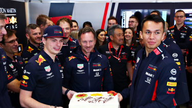 Red Bull Racing Team principal Christian Horner is presented with a birthday cake by Verstappen and Alexander Albon of Thailand.