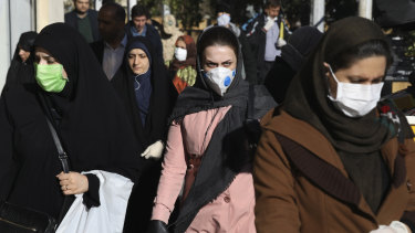 People wearing face masks in downtown Tehran on Monday.