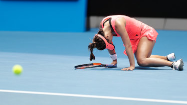 Lauren Davis feels the strain in her marathon match against Simona Halep.