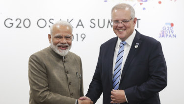 India's Prime Minister Narendra Modi with Scott Morrison in Japan in 2019.
