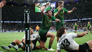 Kyle Feldt of Australia celebrates scoring a try in the men's final against New Zealand at Bankwest Stadium.