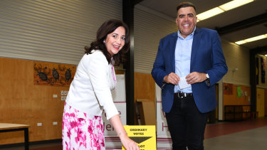 The premier casts her vote on election day with federal member for Oxley Milton Dick.