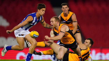 Too hot to handle: Hawk Tom Mitchell passes out under pressure as Jaeger O'Meara looks on.