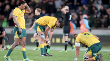Spent: Wallabies players after full-time of Saturday's match against New Zealand at Eden Park.