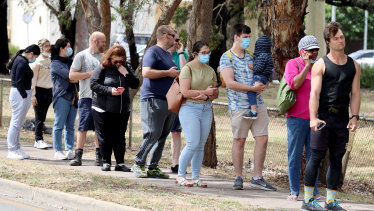 People queuing at a COVID-19 testing site at Parafield Airport in Adelaide on Monday.
