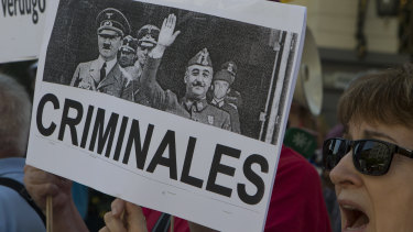 A protester holds a banner with a photo of Spanish dictator General Francisco Franco, right, with Adolf Hitler during a protest in Madrid, Spain, last month.