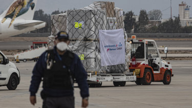 A truck transports a first shipment of the AstraZeneca COVID-19 vaccine in Santiago, Chile.