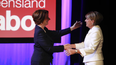 Then-prime minister Julia Gillard greets Queensland premier Anna Bligh at the 2012 campaign launch.