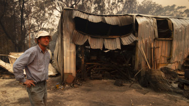 Rob Meggs inspects his shed after the Wrights Creek fire swept through the outskirts of Kulnura, west of the Central Coast.