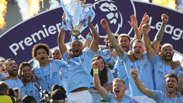 Too strong: Manchester City celebrate another title success.