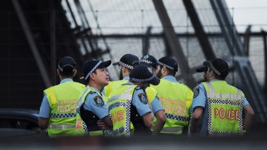 Police stand on the Sydney Harbour Bridge during a police operation on Wednesday morning.