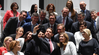 Former state development minister Cameron Dick (centre) takes a selfie with his fellow ministers after a swearing in ceremony in 2017.