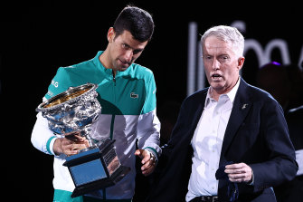 Novak Djokovic with CEO of Tennis Australia Craig Tiley as he holds the Norman Brookes Challenge Cup.