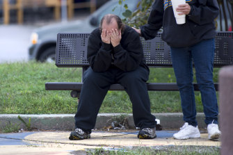 David Thevo of Kansas City, Kansas, is consoled by a friend after two gunmen entered a bar early on Sunday and shot multiple people.