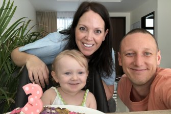Australian Zack Dwyer and South African Kate Leff with their daughter are living in Thailand and must travel to Australia to activate Ms Leff's migrant partner visa.