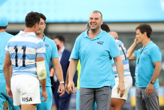 Former Wallabies coach Michael Cheika, who now works with Argentina, celebrates with the team.
