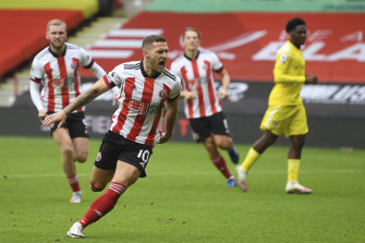 Sheffield United's Billy Sharp after scoring his side's opening goal from the penalty spot against Fulham at Bramall Lane on Sunday.