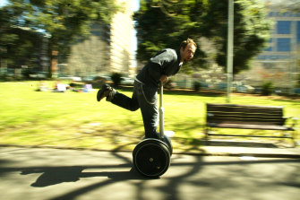 Kevin Adams rides one of the first Segways in Australia through Sydney's Belmore Park in 2003.