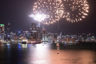 Fireworks are seen exploding from Auckland's Waitemata Harbour and Sky Tower.