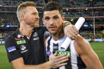Nathan Buckley with Scott Pendlebury.