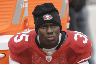 Phillip Adams, pictured sitting on the sidelines for the San Francisco 49ers in 2010.