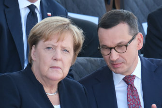 German Chancellor Angela Merkel and Polish Prime Minister Mateusz Morawiecki commemorate the 80th anniversary of the outbreak of World War II in Warsaw on Sunday.