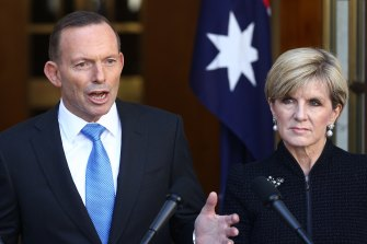 """Julie Bishop tried to keep a """"straight face"""" while defending Tony Abbott's male-dominated cabinet."""