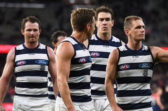 Leading Geelong players leave the field after the loss.