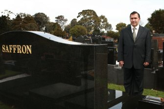 Alan Saffron at his father Abe Saffron's tombstone in Sydney on July 24, 2008.