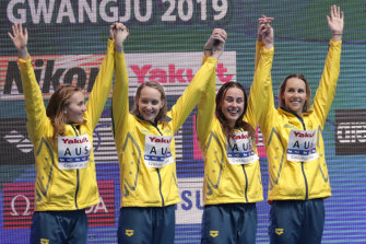 Australia's women's 4x200m freestyle relay team celebrate on the podium as they receive their gold medal at the World Swimming Championships.