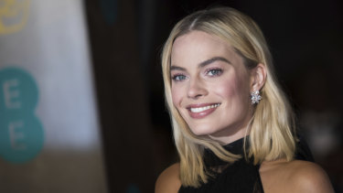 "Margot Robbie says David Higgins gets her in her ""best physical shape."""