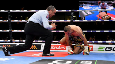 Down and out: Anthony Mundine is counted out after being felled by a left hook at Suncorp Stadium.