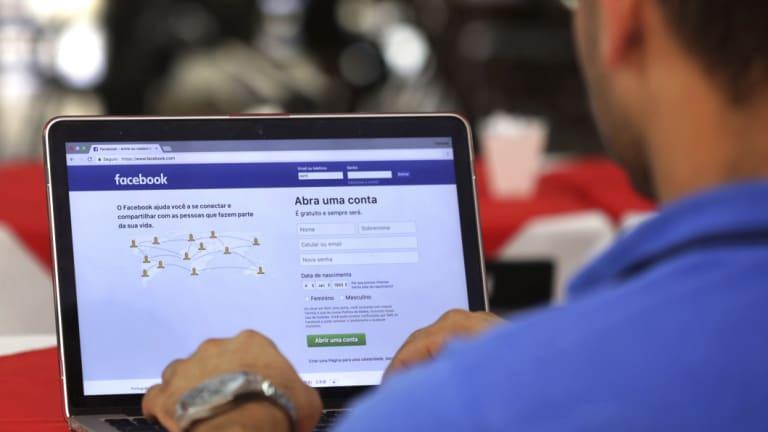 A man logs in to Facebook in Brasilia, Brazil.