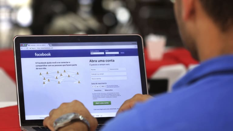 A man logs in to Facebook in Brasilia, Brazil.