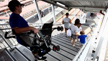 Parents forced to carry prams down the stairs at Redfern station.