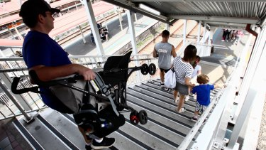 Parents are forced to carry prams down stairs at Redfern station as it has a lift serving just two of its 12 platforms.